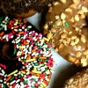 variety of donuts -- with nuts, with sprinkles