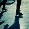 Ice skaters legs and feet, and their shadows