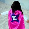 Little girl in a superhero cape