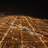Aerial view of Chicago's northside light by street lights at night