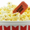 "Bucket of movie popcorn with ""admit one"" ticket"