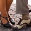 Man's and woman's feet clad in dancing shoes