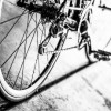 black and white photo of bicycle tires and gears