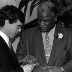 Irish Consul General Peter Gunning presents shamrocks to Mayor Harold Washington on St. Patrick's Day 1987. Source: Harold Washington Archives and Collections: Press Office Photographs, Box 60, Folder 4. Photographer: Peter J. Schulz