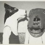 Two grotesque dog heads. Source: Chicago Park District Records: Photographs, Image 005_002_003