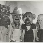 Four children wearing grotesque heads. Source: Chicago Park District Records: Photographs, Image 015_025_002