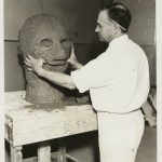 A man works on creating the clay model for a grotesque head. Source: Special Collections, Chicago Park District Records: Photographs, Image 051_009_007